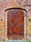 Restored wooden medieval door Royalty Free Stock Photography