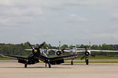 Restored World War II United States Aircraft complete their flight. A vintage US Navy Cosair and B-25 Bomber on the runway at MCAS Beaufort for the airshow Stock Photos