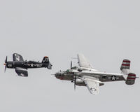 Restored World War II United States Aircraft take to the sky. A vintage US Navy Cosair and B-25 Bomber fly over MCAS Beaufort for the airshow Stock Photography