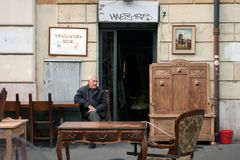 Restorer of old  furniture in front of his shop in Rome Royalty Free Stock Photo