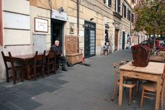 Restorer of old  furniture in front of his shop in Rome Royalty Free Stock Photography