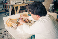 Restorer working with antique decor Royalty Free Stock Photo