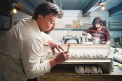 Restorers working with gypsum models Stock Photo