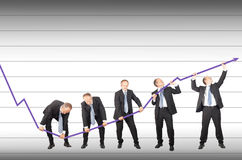 Restoring decreasing trend. Businessmen are joining the effort to restore decreasing trend Royalty Free Stock Photo