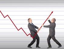 Restoring decreasing trend. Businessmen are joining the effort to restore decreasing trend Royalty Free Stock Images