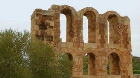 Restos de la fachada de piedra antigua del edificio, preservación antigua del patrimonio cultural almacen de video