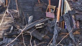 Restos del quemado abajo de casa Fotografía de archivo