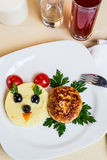 Restourant serving dish for child`s menu - potato puree, cutlet Stock Image
