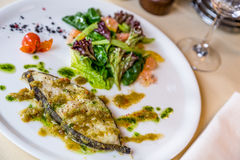 Restourant serving dish  roast slice fish on table Stock Photo