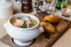 Restourant serving dish - salmon soup on wooden board with pie, Stock Images