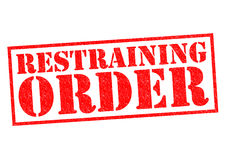 RESTRAINING ORDER. Red Rubber Stamp over a white background Royalty Free Stock Images
