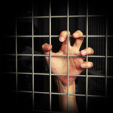 Restraint of liberty. Hand holding a metal grid. restraint of liberty concept Royalty Free Stock Photography