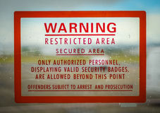 Restricted Access Sign. A Red Airport Security Restricted Area Warning Sign Stock Photography