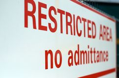 Restricted area. White sign with red letters gives advice of restricted area Stock Image