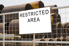 Restricted Area. Sign that tell this is a Restricted Area royalty free stock photos