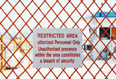 Restricted area. A security sign outside a restricted area Royalty Free Stock Image