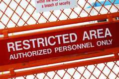 Restricted area. A security sign outside a restricted area royalty free stock photo