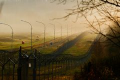 Restricted Area. Barbed Wire Fence At The State Border Stock Photos