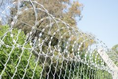 Fence with barbed wire. Restricted area - fence with barbed wire Stock Images