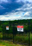 Restricted area. A fence with a restricted area sign Stock Photography