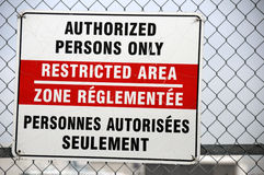 Restricted Area Sign. Authorized persons only sign at busy international airport Stock Photography