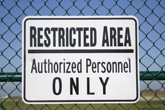 Restricted Area Sign. Restricted Area - Authorized Personnel Only -- sign posted outside of an airport royalty free stock images