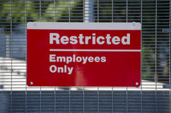 Restricted Area Sign. Restricted Area - Authorized Personnel Only. Keep off Fence. Posted at a Power Plant Stock Image