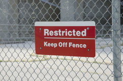 Restricted Area Sign. Restricted Area - Authorized Personnel Only. Keep off Fence. Posted at a Power Plant Royalty Free Stock Photo
