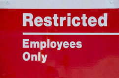 Restricted Area Sign. Restricted Area - Authorized Personnel Only. Keep off Fence. Posted at a Power Plant Royalty Free Stock Photos