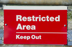 Restricted Area Sign. Restricted Area - Authorized Personnel Only. Keep off Fence. Posted at a Power Plant Stock Photos