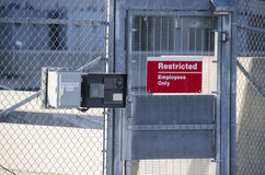 Restricted Area Sign in gated industrial power plant. Restricted Area - Authorized Personnel Only. Keep off Fence. Posted at a Power Plant Stock Photos