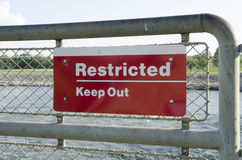 Restricted Area Sign Keep Out!. Restricted Area - Authorized Personnel Only. Keep off Fence. Posted at a Power Plant Stock Photography