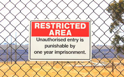 Restricted area warning sign. On wire fence protecting a power plant in australia Royalty Free Stock Images