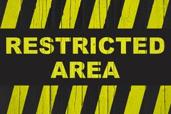 Restricted area  warning sign with yellow and black stripes Stock Photo