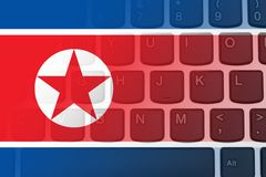 Restricted Internet access in North Korea. The North Korean flag on a computer keyboard Royalty Free Stock Photo