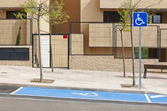 Restricted parking zone for disabled on an urban area. Accessibility. Restricted parking zone for disabled on a residencial urban area stock image