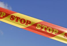 Restricted ribbon. Restricted area strip with written STOP sign Stock Photography