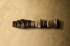 RESTRICTION - close-up of grungy vintage typeset word on metal backdrop Royalty Free Stock Images