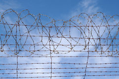 Restrictions barbed wire blue sky Stock Photography