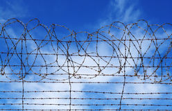 Restrictions barbed wire blue sky Stock Photos