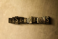 RESTRICTIONS - close-up of grungy vintage typeset word on metal backdrop Stock Images