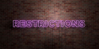 RESTRICTIONS - fluorescent Neon tube Sign on brickwork - Front view - 3D rendered royalty free stock picture Royalty Free Stock Images