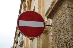 Restrictive sign on the ancient wall Stock Photo