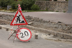 The restrictive sign on the sidewalk Repairs and  the sign Speed limit within 20 km/h are opposite the place of repairs Royalty Free Stock Photos
