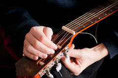 Restring acoustic guitar, close up Royalty Free Stock Photo