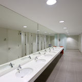Restroom. View of a public empty restroom with mirror royalty free stock photography