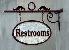 Restroom. Elaborate Hanging Sign For Restrooms Royalty Free Stock Images