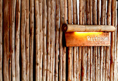 Wood restroom direction. Restroom direction plate made from bamboo make you feel clam and fresh with nature Royalty Free Stock Image