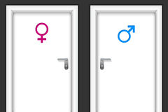 Restroom doors with gender symbols Royalty Free Stock Images