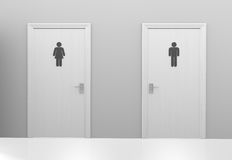 Restroom doors to public toilets with men and women icons. Two closed restroom doors with gender symbol signs designating male and female public toilets Royalty Free Stock Images